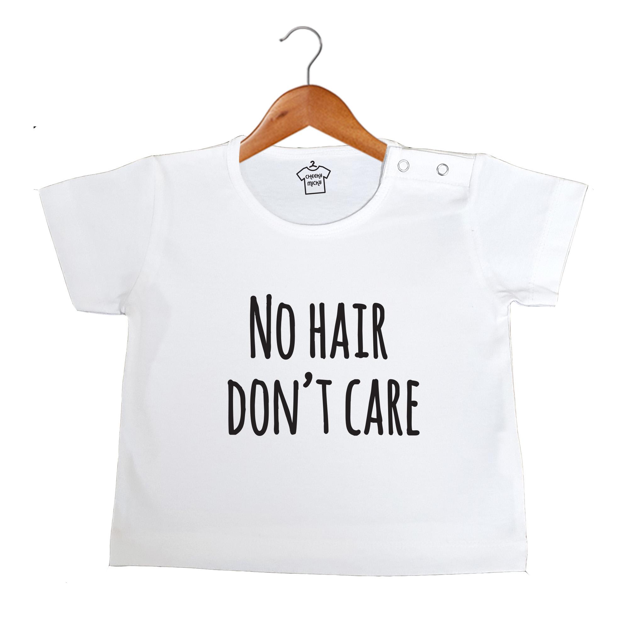 White T-shirt, 100% cotton, machine washable. Age 6-12 months. Print: No Hair Don't Care.